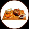 Рулька свиная на гарнире из тушеной капусты с медово-горчичным соусом и соусом BBQ
